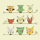 Set of cute cartoon owls on a yellow background stock illustration