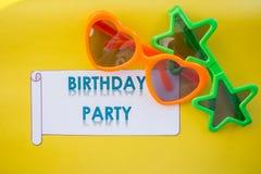 Set of cute celebratory sunglasses saying happy birthday.Birthday party concept. Funny sunny glasses on yellow. A pair of cute celebratory sunglasses saying royalty free stock photos