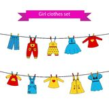 Set of cute color dresses for the little girl Stock Photo