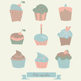Set of cute cupcakes. Colorful set of cute cupcakes with candles, cherries, strawberry, cream, confetti in cartoon style Royalty Free Stock Photo