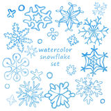 Set of cute drawn by hand snowflakes with watercolor texture Royalty Free Stock Images