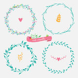 Set of cute floral wreaths. Four floral green wreaths, vector floral wreath with flowers and leaves stock illustration