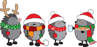 Set of 4 cute hedgehogs dressed for Christmas Royalty Free Stock Photo
