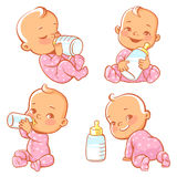 Set with cute little baby with bottle of milk. Newborn baby girl in pink pajamas drink milk.. Feeding newborn with formula or mother`s milk. Happy toddler Royalty Free Stock Images
