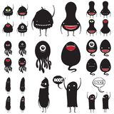 Set of cute little black monsters Stock Photos