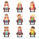 Set of cute little kids in 3D-glasses. Cute little kids in 3D-glasses on red chairs in movie theater set. Collection with different children s facial emotions in Royalty Free Stock Image