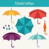 Set of cute multicolor umbrellas in flat design Stock Photos