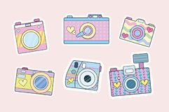 Set of cute retro cameras isolated on blush pink background. Vec royalty free illustration