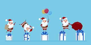 Set of cute santa claus character in a variety of gestureson on gift boxes Stock Photos