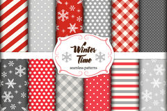 Set of 12 cute seamless Winter Time patterns with traditional ornaments Royalty Free Stock Photo