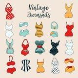 Set of 17 cute stylish hand drawn swimsuits. Vector Illustration