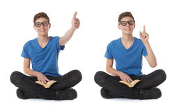 Set of cute teenager boy over white isolated background. Cute teenager boy showing thumb up sign with book in blue T-shirt, glasses and lotus posture over white Stock Photos