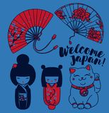 Set of cute traditional souvenirs of Japan or another asian countries. Set of cute traditional souvenirs of Japan: asian hand paper fans, kokeshi - wooden doll Stock Photos