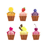 Set of cute vector cupcakes and muffins. Vector illustration. Cartoon illustration of tasty cupcake. Lemon,berries, chocolate and orange tasty cupcakes set Stock Photos