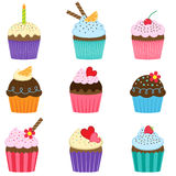 Set of cute vector cupcakes. Vector set of nine different cute cupcakes Stock Image