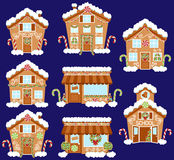 Set of Cute Vector Holiday Gingerbread Houses, Shops and Other Buildings. With Snow Stock Image