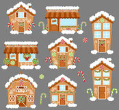 Set of Cute Vector Holiday Gingerbread Houses, Shops and Other Buildings. With Snow Royalty Free Stock Photo