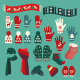Set of cute warm Christmas mittens, stockings and hats Royalty Free Stock Photos