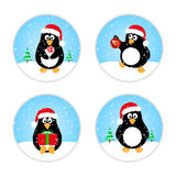 Set of cute winter penguins in Santa hat. With Christmas decoration, gift, caramel. Vector illustration. Concept for winter web-design, magnets, icons, cards stock illustration