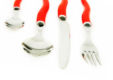 Set of cutlery. With red handles, isolated Royalty Free Stock Photo