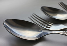 A set of cutlery with forks and spoons Stock Images