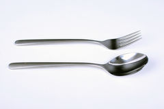 Set of cutlery. Metal fork and spoon with matte handle on white background. Stock Photo