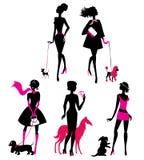 Set czarne sylwetki modne dziewczyny z ich zwierzętami domowymi Zdjęcia Royalty Free