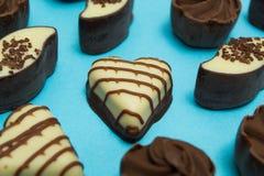 Set czekoladowi cukierki w r zdjęcie royalty free
