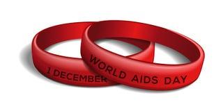 Set czerwone plastikowe bransoletki dla światu POMAGA dzień Obrazy Stock