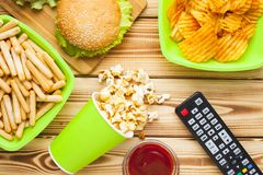 Weekend at home, leisure lifestyle, TV, fast food concept. stock photography