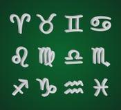 Set of 3D zodiac symbols. White symbols on the green background Stock Image