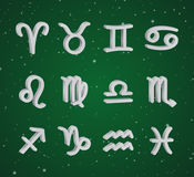 Set of 3D zodiac symbols. White icons on the background of green starry sky Stock Image