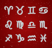 Set of 3D zodiac symbols. White icons on the background of red starry sky Royalty Free Stock Photos