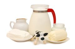 Set of dairy products and a toy cow Royalty Free Stock Photos