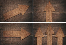 Set of dark brown wooden arrow are on board Royalty Free Stock Image