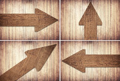 Set of dark brown wooden arrow are on wall.  Royalty Free Stock Photography