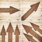 Set of dark brown wooden arrow are on wall.  Stock Photography