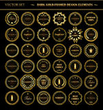 Set of dark gold-framed design elements. Royalty Free Stock Image