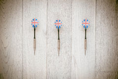 Set of darts on wooden background. Royalty Free Stock Images