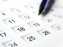 Set a date 2. Blue pen on a calendar Royalty Free Stock Photo