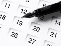 Set a date 4. Black classic pen on a calendar Stock Image