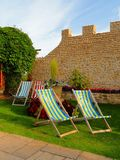 Set Of Deckchairs Within Garden Stock Images