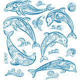 Set of decorated dolphins Stock Photos
