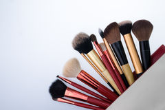 Set of decorative brush cosmetics on white background. Set of decorative brush cosmetics in bag on white background Stock Photography