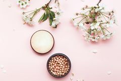 Set of decorative cosmetics for make-up powder balls and. Spring blossom, top view Royalty Free Stock Image