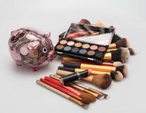 Set of decorative cosmetics with piggybank on white background Stock Photos