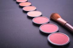 Set of decorative cosmetics and soft brush on stone Royalty Free Stock Images