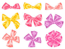 Set of decorative delicate satin gift bows and ribbons.  Royalty Free Stock Photo