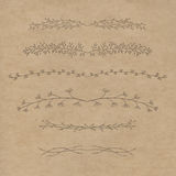 Set of decorative doodle branches. Six different branches and symmetrical reflection. Kraft background Stock Photo