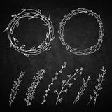 Set of decorative doodle wreaths made of branches. Royalty Free Stock Image